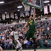 4th year guard Alex Igual (4) of the Regina Cougars in action during the home game on December  3 at Centre for Kinesiology, Health and Sport. Credit: Matt Johnson/Arthur Images