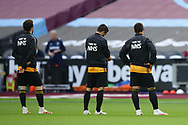 Wolves players display a thank you to the NHS on the back of their track suits during the Premier League match at the London Stadium, London. Picture date: 20th June 2020. Picture credit should read: David Klein/Sportimage