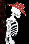 Skeleton of cowboy with hat, cutout sign, Nevada Desert