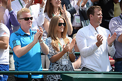 © Licensed to London News Pictures. 25/06/2014. LONDON, UK Wimbledon Tennis Championships 2014<br /> Day 3. Kim Sears applauds her boyfriend's watching Andrew Murray, GBR during his victory over Blaz Rola, SLO.  Photo credit : Mike King/LNP