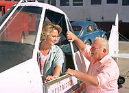 Barbara Tomalino (left), owner of Paramount Air Service and her father, Andre Tomalino, founder of Paramount Air Service, speaks with his daughter while standing next to one of the company airplanes Friday, July 23, 1993 at Cape May County Airport in Lower Township, New Jersey. (Photo by William Thomas Cain/Cain Images)