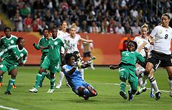 30.06.2011, Commerzbank Arena, Frankfurt, GER, FIFA Women Worldcup 2011, Gruppe A, Deutschland (GER) vs. Nigeria (NGA), im Bild .Inka Grings (re./GER) gegen Torhüterin Precious Dede und Ebere Orji (beide NGA) .// during the FIFA Women Worldcup 2011, Pool A, Germany vs Nigeria on 2011/06/30, Commerzbank Arena, Frankfurt, Germany.  EXPA Pictures © 2011, PhotoCredit: EXPA/ nph/  Karina Hessland       ****** out of GER / CRO  / BEL ******