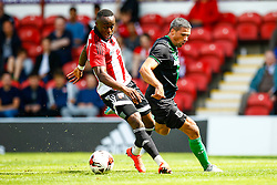 Moses Odubajo of Brentford tackles Jonathan Walters of Stoke City - Mandatory by-line: Jason Brown/JMP - Mobile 07966 386802 25/07/2015 - SPORT - FOOTBALL - Brentford, Griffin Park - Brentford v Stoke City - Pre-Season Friendly