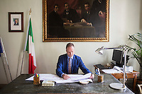 FLORENCE, ITALY - 29 JUNE 2016: The new director of the Uffizi Gallery Eike Schmidt studies a plan of the museum space here in his office at the Uffizi Gallery in Florence, Italy, on June 29th 2016.<br /> <br /> Art historian Eike Schmidt, former curator and head of the Department of Sculpture, Applied Art and Textiles at the Minneapolis Institute of Arts, became the first non-Italian director of the Uffizi in August 2015, replacing Antonio Natali who directed the gallery for 9 years. One of the main goals of the new director is to open the Vasari Corridor to the general public. Currently the corridor can only be visited with group reservations made by external tour and travel agencies throughout the year.<br /> <br /> The Vasari Corridor is is a 1-kilometer-long (more than half mile) elevated enclosed passageway which connects the Palazzo Vecchio with the Palazzo Pitti, passing through the Uffizi Gallery and crossing the Ponte Vecchio above the Arno River, in Florence. The passageway was designed and built in 1564 by Giorgio Vasari in only 6 months to allow Cosimo de' Medici and other Florentine elite to walk safely through the city, from the seat of power in Palazzo Vecchio to their private residence, Palazzo Pitti. The passageway contains over 1000 paintings, dating from the 17th and 18th centuries, including the largest and very important collection of self-portraits by some of the most famous masters of painting from the 16th to the 20th century, including Filippo Lippi, Rembrandt, Velazquez, Delacroix and Ensor.