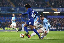 Chelsea's Willian (left) in action