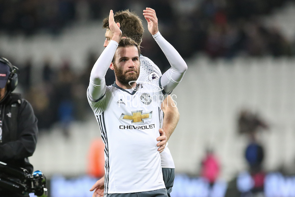 Juan Mata Midfielder of Manchester United celebrates with fans during the Premier League match between West Ham United and Manchester United at the Stadium Queen Elizabeth Olympic Park, London, United Kingdom on 2 January 2017. Photo by Phil Duncan.