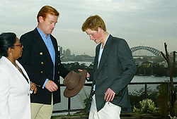 File photo dated 23/09/03 of Prince Harry with aides Colleen Harris and Mark Dyer in Sydney, Australia. The Duchess of Sussex looks set to have turned to her inner circle of faithful friends for son Archie's godparents.