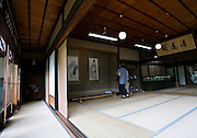 Visitors look at scrolls on the first floor reception room of the main building of the Honma Museum of Art in Sakata, Yamagata Prefecture, Japan, on July 06, 2012. Construction of the reception room was started around 200 years ago. Photographer: Robert Gilhooly