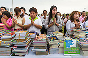 """23 APRIL 2013 - BANGKOK, THAILAND:  People pray during the opening ceremony to mark Bangkok as the World Book Capital City 2013. UNESCO awarded Bangkok the title. Bangkok is the 13th city to assume the title of """"World Book Capital"""", taking over from Yerevan, Armenia. Bangkok Governor Suhumbhand Paribatra announced plans that the Bangkok Metropolitan Administration (BMA) intends to encourage reading among Thais. The BMA runs 37 public libraries in the city and has modernised 14 of them. It plans to build 10 more public libraries every year. Port Harcourt, Nigeria will be the next World Book Capital in 2014. <br /> PHOTO BY JACK KURTZ"""