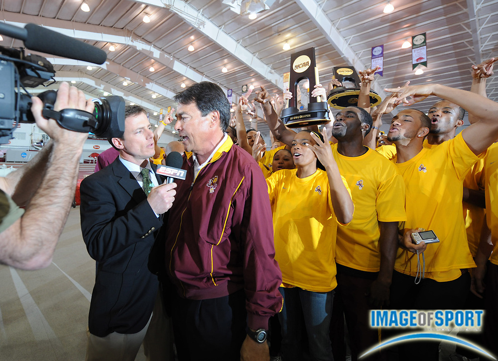 Mar 15, 2008; Fayetteville, AR, USA; Arizona State coach Greg Kraft is interviewed by ESPN2 after the Sun Devils swept the men's and women's team titles in the NCAA indoor track and field championships at the Randal Tyson Center.