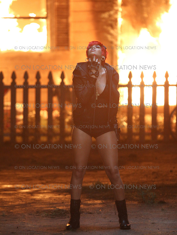 """July 21st  2010 Los Angeles, CA. ***EXCLUSIVE*** Rihanna performs in front of a burning house while filming a music video with Eminem  for """"The Way You Lie"""". Eminem was later seen but not photographed performing together with Rihanna in front of the burning house. Photo by Danny Mayer/ Eric Ford/ On Location News 818-613-3955 info@onlocationnews.com"""