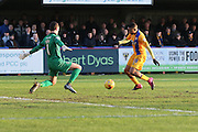 James Shea (Goalkeeper) of AFC Wimbledon stops Reggie Lambe of Mansfield Town doubling their lead during the Sky Bet League 2 match between AFC Wimbledon and Mansfield Town at the Cherry Red Records Stadium, Kingston, England on 16 January 2016. Photo by Stuart Butcher.
