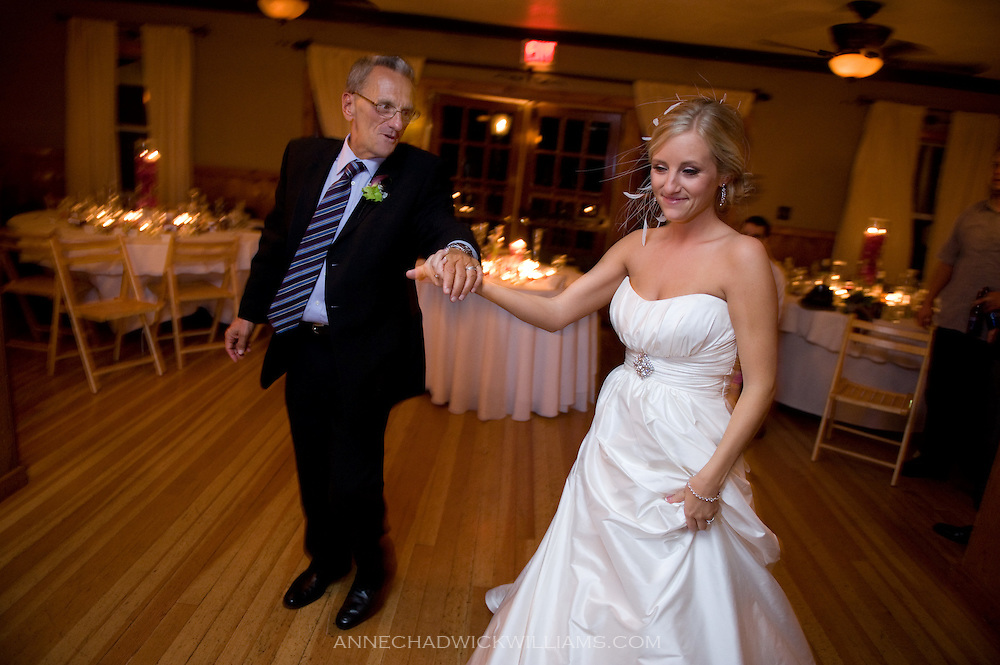 A bride dances with her father at her wedding at Forest House Lodge in Foresthill, CA.