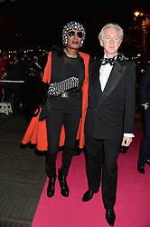 GRACE JONES and PHILIP TREACY at a private view of Isabella Blow: Fashion Galore! held at Somerset House, London on 19th November 2013.