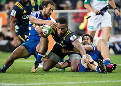 Highlanders' Tevita Nabura, centre, is tackled by Stormers' Dillyn Leyds, left, and EW Viljoen in the Super Rugby match, Forsyth Barr Stadium, Dunedin, New Zealand, Friday, March 9, 2018. Credit:SNPA / Adam Binns ** NO ARCHIVING**