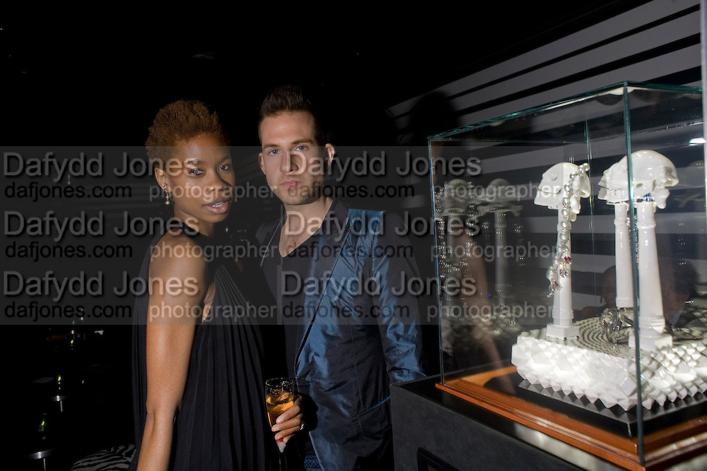 Tallulah Adeyemi and Dickie Storer, Weinstein Bafta after-party in association with Chopard. Bungalow 8. London. 10  February 2008.  *** Local Caption *** -DO NOT ARCHIVE-© Copyright Photograph by Dafydd Jones. 248 Clapham Rd. London SW9 0PZ. Tel 0207 820 0771. www.dafjones.com.