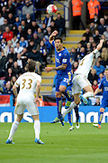 Leicester City forward Leonardo Ulloa beats Swansea City midfielder Jack Cork to a header during the Barclays Premier League match between Leicester City and Swansea City at the King Power Stadium, Leicester, England on 24 April 2016. Photo by Alan Franklin.