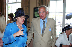 Left to right, BARONESS CHALKER and LORD GUTHERIE at the King George VI and The Queen Elizabeth Diamond Stakes sponsored by De Beers for the 33rd year held at Ascot Racecourse, Berkshire on July 24th 2004.