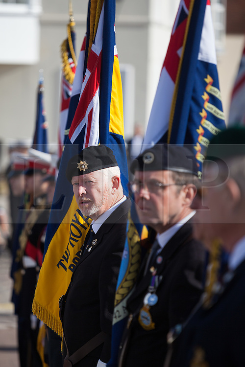 © Licensed to London News Pictures. 16/10/2016. Portsmouth, Hampshire, UK. Standard bearers lined up next to the statue of Lord Nelson in the annual service for seafarers. Lord-Lieutenant of Hampshire, NIGEL ATKINSON and Lord Mayor of Portsmouth, Councillor DAVID FULLER, have taken part in the annual Seafarer's Service held at Portsmouth Cathedral, and the laying of wreaths at the statue of Lord Nelson. The service is held annually, on the first Sunday prior to the anniversary of the Battle of Trafalgar, 21st October, and remembers those who have lost their lives at sea, and also commemorates the life of Lord Horatio Nelson. Photo credit: Rob Arnold/LNP