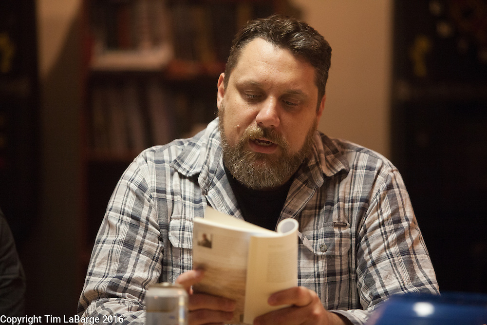 Sean Davis leads a group in reading and writing during a War Stories meeting at the American Legion Post 134. Photo © Tim LaBarge 2016