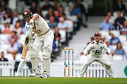 Wicket! Jamie Smith of Surrey is out lbw bowled by Grant Stewart of Kent during the Specsavers County Champ Div 1 match between Surrey County Cricket Club and Kent County Cricket Club at the Kia Oval, Kennington, United Kingdom on 7 July 2019.