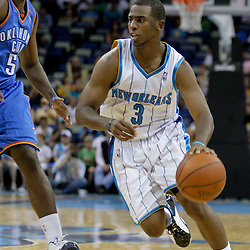 Oct 10, 2009; New Orleans, LA, USA; New Orleans Hornets guard Chris Paul drives past Oklahoma City Thunder guard Kyle Weaver (5) during a preseason game at the New Orleans Arena. The Hornets defeated the Thunder 88-79. Mandatory Credit: Derick E. Hingle-US PRESSWIRE