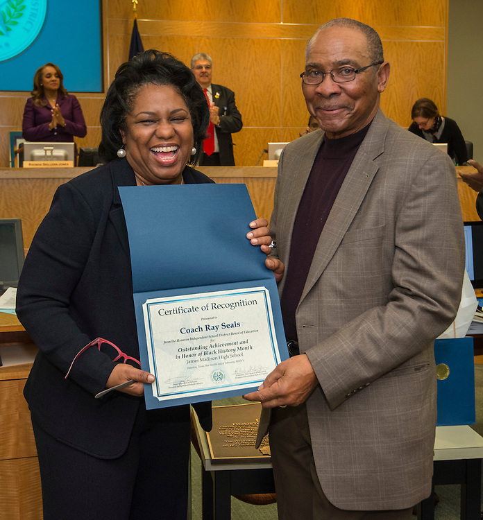 Houston ISD Board of Trustees member Paula Harris recognizes former Madison High School football coach Ray Seals during the Board of Trustees meeting, February 12, 2015.