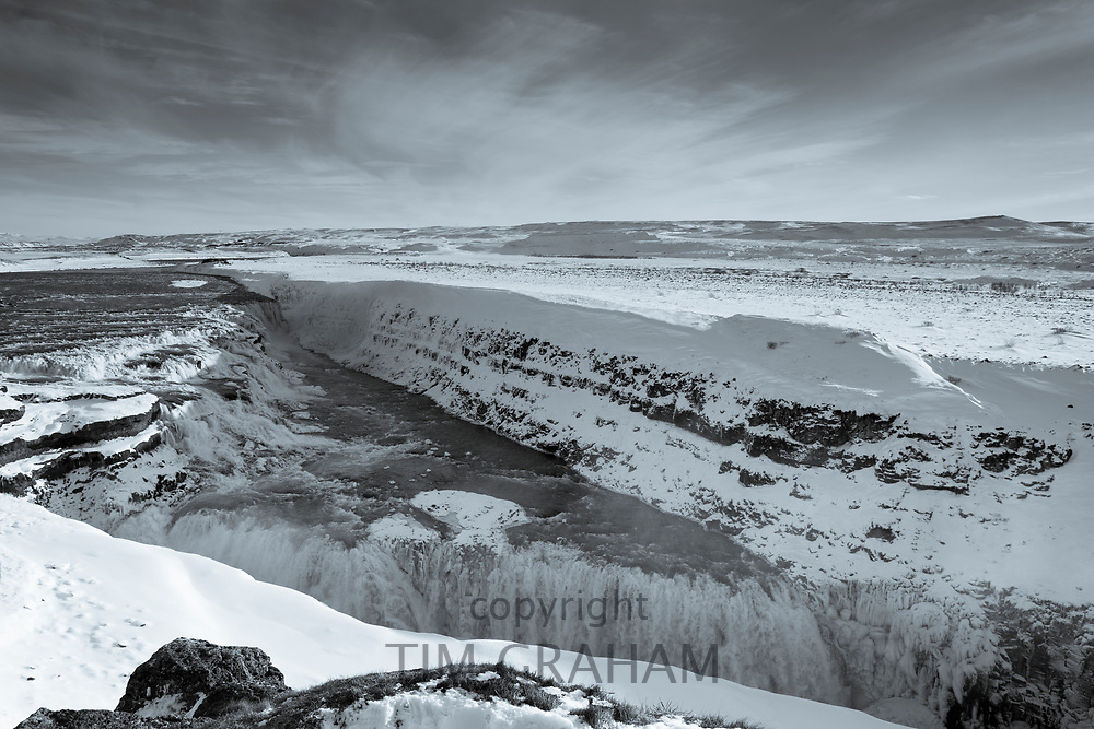 Gushing, flowing glacial river water at falls of Gullfoss Waterfall in glacial landscape of South Iceland