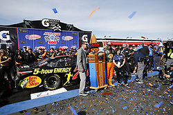 FONTANA, CA -  MARCH 18: Martin Truex Jr., driver of the #78 Bass Pro Shops/5-hour ENERGY Toyota wins the 2018 Monster Energy Cup Series NASCAR Auto Club 400. Truex Jr., 2017 Cup Series champion dominated from start to finish, winning the pole and all of the stages. He is the only driver in NASCAR history to accomplish it. Byline, credit, TV usage, web usage or linkback must read SILVEXPHOTO.COM. Failure to byline correctly will incur double the agreed fee. Tel: +1 714 504 6870.