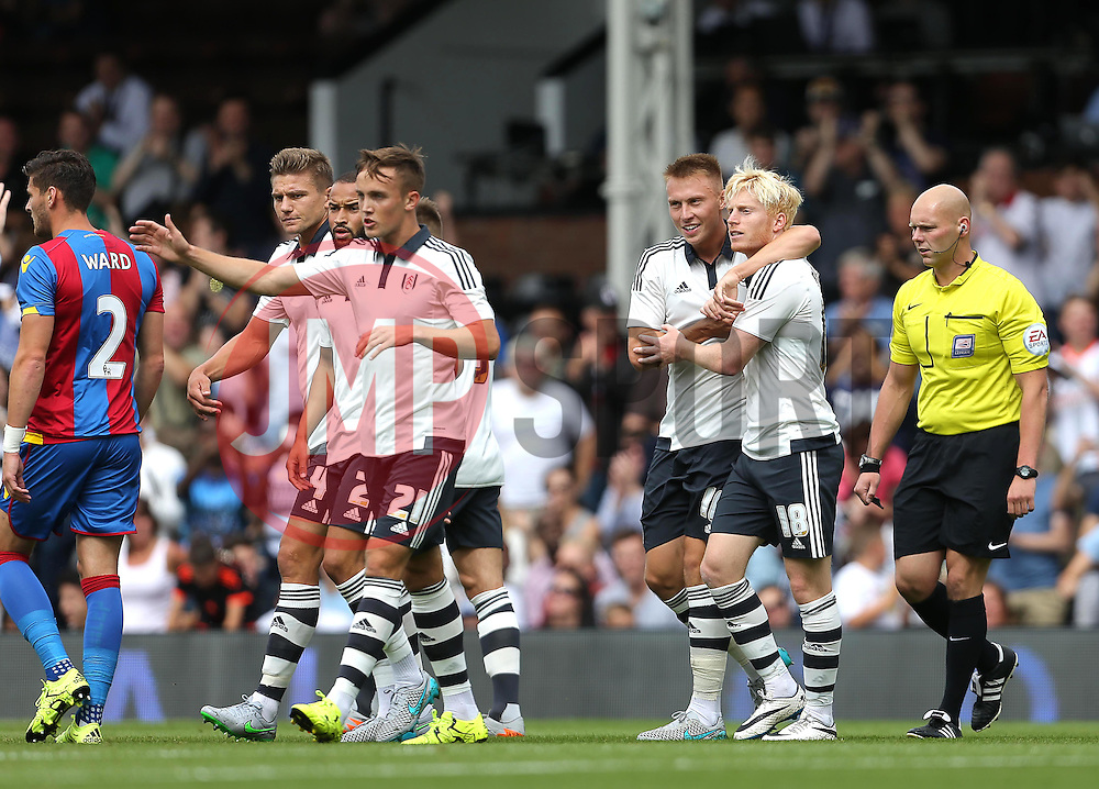 Ben Pringle ( 2nd R ) of Fulham celebrates after he scores the opening goal of the game - Mandatory by-line: Paul Terry/JMP - 07966386802 - 01/08/2015 - SPORT - FOOTBALL - Fulham,England - Craven Cottage - Fulham v Crystal Palace - Pre-Season Friendly