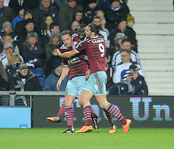 West Ham's Kevin Nolan celebrates his goal with West Ham's Cheikhou Kouyate and West Ham's Andy Carroll - Photo mandatory by-line: Dougie Allward/JMP - Mobile: 07966 386802 - 02/12/2014 - SPORT - Football - West Bromwich - The Hawthorns - West Bromwich Albion v West Ham United - Barclays Premier League