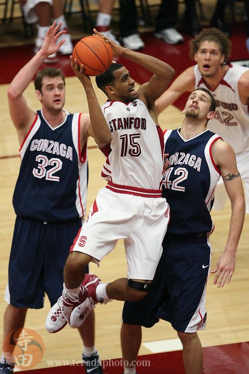 January 31, 2007; Stanford, CA, USA; Stanford Cardinal forward Lawrence Hill (15) shoots the basketball against Gonzaga Bulldogs forward Sean Mallon (32) and forward Josh Heytvelt (42) during the game at Maples Pavilion. The Bulldogs defeated the Cardinal 90-86.