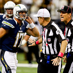 October 7, 2012; New Orleans, LA, USA; San Diego Chargers quarterback Philip Rivers (17) argues with referee Carl Cheffers (51) and back judge Todd Prukop (30) during the fourth quarter of a game against the New Orleans Saints at the Mercedes-Benz Superdome. The Saints defeated the Chargers 31-24. Mandatory Credit: Derick E. Hingle-US PRESSWIRE