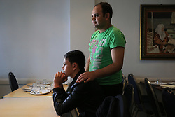 Brothers Asif Khan (standing) and Aemal Khan in Hounslow, London, who were reunited when Aemal arrived from the so-called Jungle camp in Calais, France.