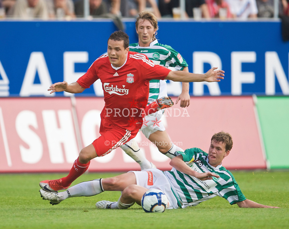 ST GALLEN, SWITZERLAND - Wednesday, July 15, 2009: Liverpool's Philipp Degen is tackled by St Gallen's Fabian Frei during the opening preseason friendly match  at the AFG Arena. (Pic by David Rawcliffe/Propaganda)