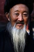 CHINA: Beijing.Portrait of elderly man with beard, inside the Frobidden City.