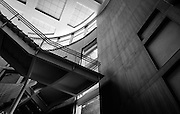 The center of this building features a large circular atrium containing an open stairwell. The architectural lines, shapes and texture make for compelling architectural abstract imagery. The natural lighting and choice of materials also enables a beautiful, broad range of tonalities.