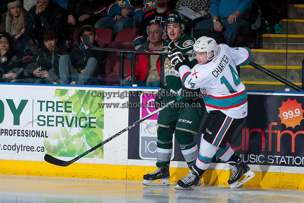 KELOWNA, CANADA - JANUARY 08: Rourke Chartier #14 of Kelowna Rockets checks Graham Millar #22 of Everett Silvertips at the boards on January 8, 2016 at Prospera Place in Kelowna, British Columbia, Canada.  (Photo by Marissa Baecker/Shoot the Breeze)  *** Local Caption *** Rourke Chartier; Graham Millar;