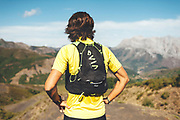 Back view of utra trail runner lookintg to horizon Trail runner running uphill in Collado Jermoso, Picos de Europa National Park, Spain