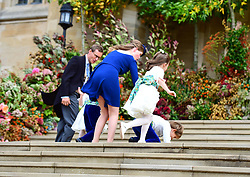 Louis de Givenchy falls on the steps, as the bridesmaids and page boys arrive with Lady Louise Mountbatten-Windsor, for the wedding of Princess Eugenie to Jack Brooksbank at St George's Chapel in Windsor Castle.