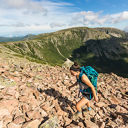 A teenage girl hikes at the top of the Cathedral Trail on Mount Katahdin in Maine's Baxter State Park.