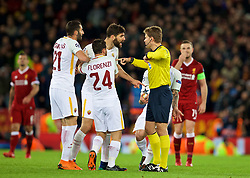 LIVERPOOL, ENGLAND - Tuesday, April 24, 2018: AS Roma's Federico Fazio is shown a yellow card by referee Felix Brych during the UEFA Champions League Semi-Final 1st Leg match between Liverpool FC and AS Roma at Anfield. (Pic by David Rawcliffe/Propaganda)