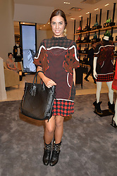 AMBER LE BON at a lunch hosted by Alice Naylor-Leyland and Tamara Beckwith in celebration of the Coach 2015 collection held at Coach, New Bond Street, London on 18th September 2014.