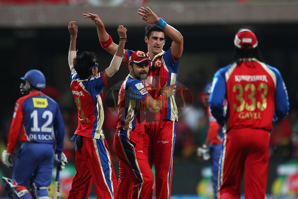 Mitchell Starc of the Royal Challengers Bangalore celebrates the wicket of Quinton de Kock of the Delhi Daredevils during match 38 of the Pepsi Indian Premier League Season 2014 between the Royal Challengers Bangalore and the Delhi Daredevils held at the M. Chinnaswamy Stadium, Bangalore, India on the 13th May  2014<br /> <br /> Photo by Ron Gaunt / IPL / SPORTZPICS<br /> <br /> <br /> <br /> Image use subject to terms and conditions which can be found here:  http://sportzpics.photoshelter.com/gallery/Pepsi-IPL-Image-terms-and-conditions/G00004VW1IVJ.gB0/C0000TScjhBM6ikg