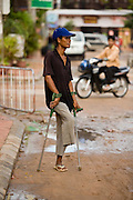 26 JUNE 2006 - SIEM REAP, CAMBODIA: OEK EANG, 43, a veteran of the Cambodian Army, begs on a street in Siem Reap. Eang lost his leg to a landmine in 1987 during combat against remnants of the Khmer Rouge.  Cambodians are still wrestling with the legacy of the war in Vietnam and subsequent civil wars. At one time it was the most heavily mined country in the world and a vast swath of Cambodia, along the Thai-Cambodian border, is still mined. In 2004, more than 800 people were killed by mines and unexploded ordinance still found in the countryside. In addition to the demining operation, Aki Ra has an orphanage for 20 kids maimed by mines.  Photo by Jack Kurtz / ZUMA Press
