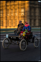 November 6, 2016 - London, London, United Kingdom - Image ©Licensed to i-Images Picture Agency. 06/11/2016. London, United Kingdom. ..The London to Brighton Veteran Car Run 2016...A 1903 Oldsmobile Curved-dash runabout driven by Anthony Whittome travels over Westminster Bridge, central London, UK, on the first leg of the journey from London to Brighton...Picture by Ben Stevens / i-Images (Credit Image: © Ben Stevens/i-Images via ZUMA Wire)
