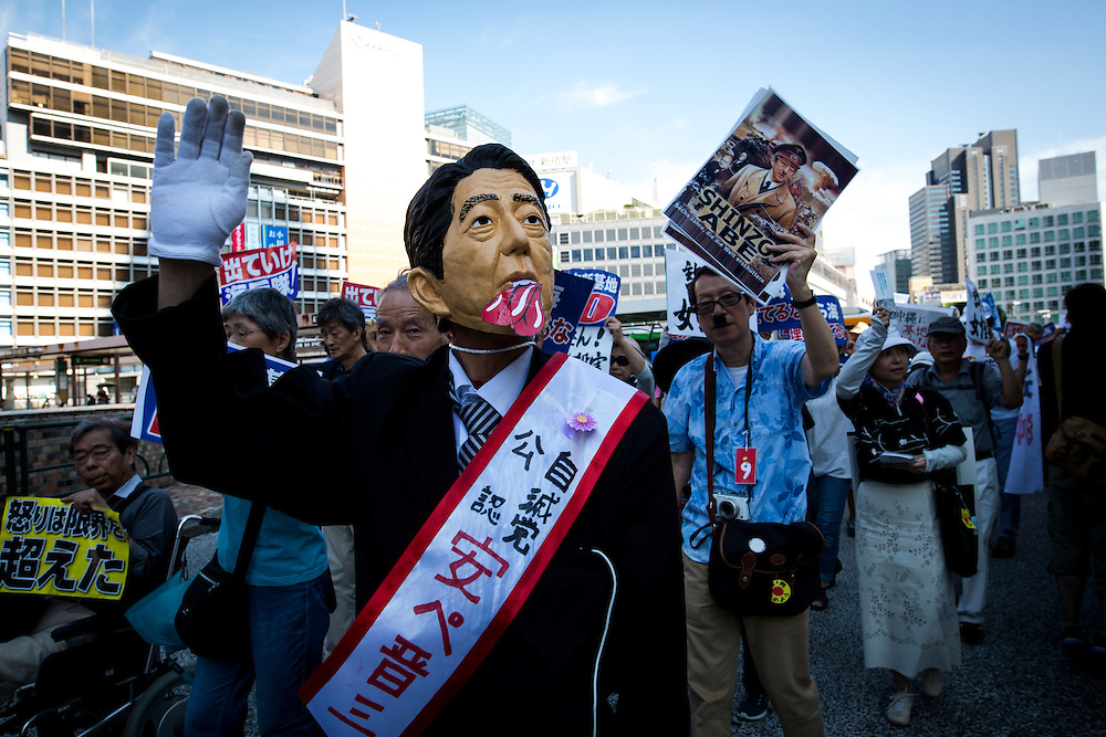 TOKYO, JAPAN - JUNE 26 : Anti U.S Airbase protesters gather during the demonstration to oppose the relocation of a U.S. Airbase in Okinawa<br />  at Shinjuku, Tokyo, Japan. June 26, 2016. Photo: Richard Atrero de Guzman