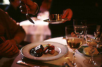 saucing meat at restaurant Alain Ducasse