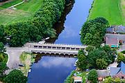 Nederland, Friesland, Gemeente Kollumerland en Nieuwkruisland, 05-08-2014; Munnekezijl, genoemd naar de sluis (zijl) in Munnikezijlsterried. Monumentale spuisluis met met de Nieuwe Friese Brug.<br /> Monumental and histotical sluice, north Netherlands.<br /> luchtfoto (toeslag op standard tarieven);<br /> aerial photo (additional fee required);<br /> copyright foto/photo Siebe Swart