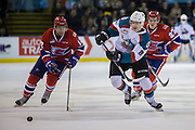 KELOWNA, CANADA - FEBRUARY 17:  Jack Cowell #8 of the Kelowna Rockets, Riley McKay #27 of the Spokane Chiefs, Alex Mowbray #12 of the Spokane Chiefs at the Kelowna Rockets game on February 17, 2017 at Prospera Place in Kelowna, British Columbia, Canada.  (Photo By Cindy Rogers/Nyasa Photography,  *** Local Caption ***